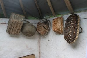 Baskets inside the compost toilet room